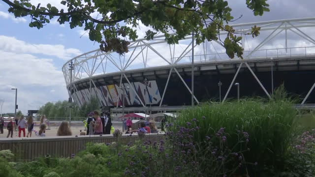 exterior shots of the stratford former olympic stadium with crowds of sports fans arriving to watch the world athletics championships - championships stock videos & royalty-free footage