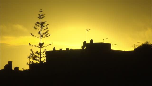 exterior shots of the sun rising over the tourist resort of praia da luz on 26 october 2016 in praia da luz, portugal - madeleine mccann stock videos & royalty-free footage