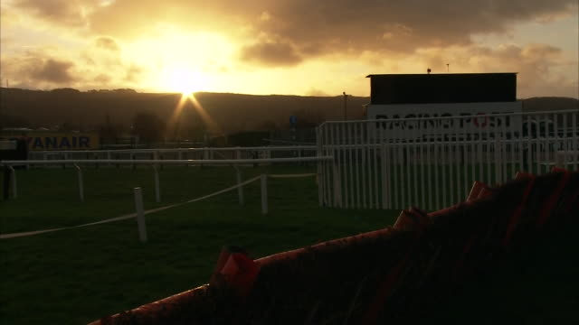 exterior shots of the sunrise at cheltenham racecourse on the 13th march, 2020 in cheltenham, england - cheltenham stock videos & royalty-free footage