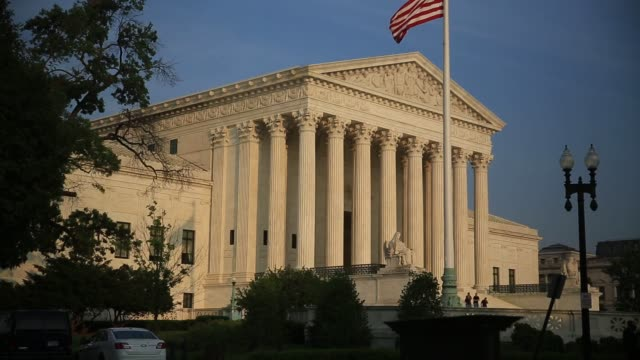 exterior shots of the supreme court building in washington dc on june 14th 2015 shots exterior shots of the supreme court building façade with the... - oberstes bundesgericht der usa stock-videos und b-roll-filmmaterial