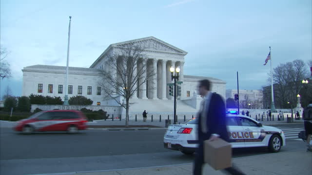 exterior shots of the supreme court of the united states with various architectural features and statues with a police car parked outside on january... - us supreme court building stock videos & royalty-free footage