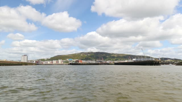 exterior shots of the swansea bay the surrounding coastline where the world's first tidal lagoon power plant is due to be built filmed at sea on june... - lagoon stock videos & royalty-free footage