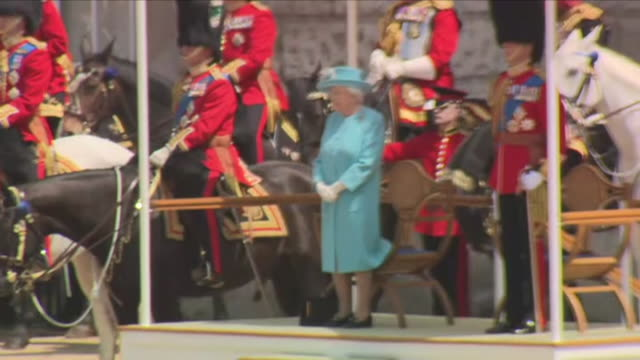 exterior shots of the the household division riding and being saluted including close up shots of the queen stood on the stage at the horse guards... - trooping the colour stock videos & royalty-free footage
