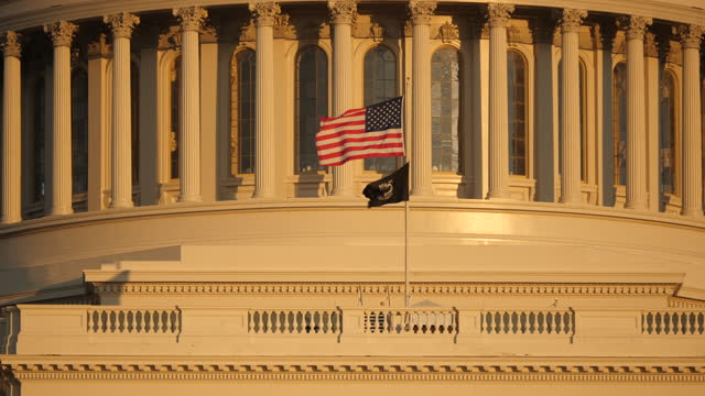 exterior shots of the us capitol rotunda and us flag & national league of families pow/mia flag in november 2020 in washington dc, united states. - flag stock videos & royalty-free footage