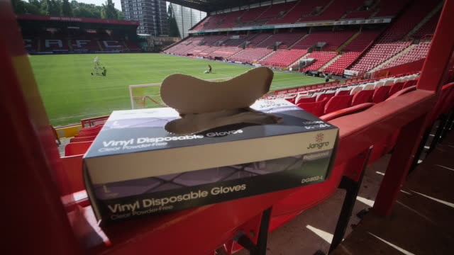 exterior shots of the valley, charlton athletic's ground, with social distancing signage being put out and groundsmen painting lines on pitch on 18... - torschuss stock-videos und b-roll-filmmaterial
