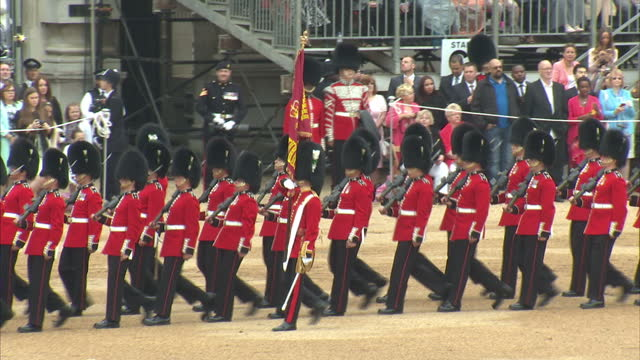vidéos et rushes de exterior shots of the welsh guards trooping the colour as the queen prince philip and the duke of kent look on from the dais>> on june 13 2015 in... - 2015
