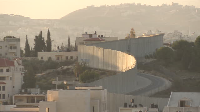exterior shots of the west bank separation barrier at east jerusalem with residential housing in east jerusalem and the palestinian territories in... - israel stock videos & royalty-free footage