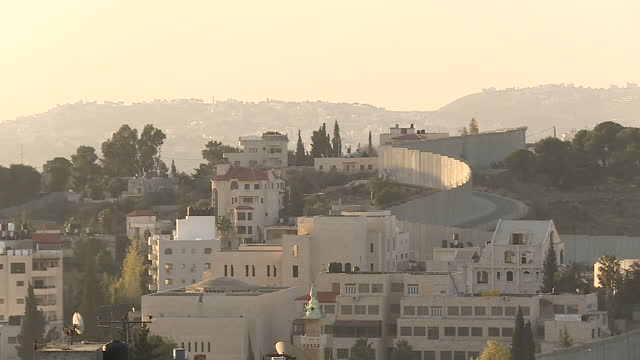 exterior shots of the west bank separation barrier at east jerusalem with residential housing in east jerusalem and the palestinian territories and a... - east jerusalem stock videos and b-roll footage