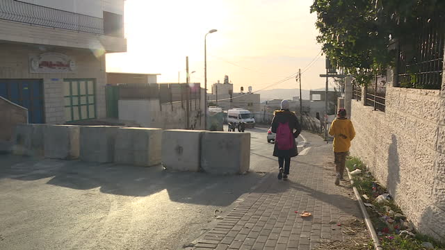 exterior shots of the west bank separation barrier at east jerusalem as a number of palestinian school children walk past on their way to school on... - east jerusalem stock videos and b-roll footage