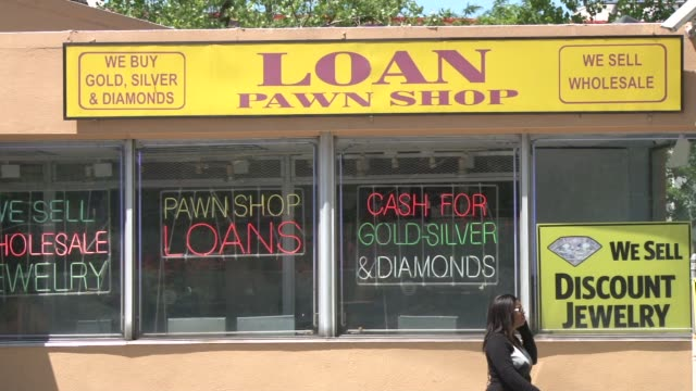 exterior shots of the westchester check cashing company and pawn shop focus on store signage and store exterior pawn shop on may 13 2012 in yonkers ny - pawnbroker stock videos & royalty-free footage