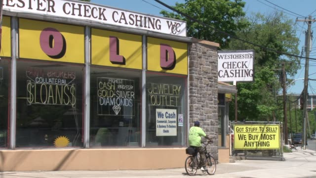 Exterior shots of the Westchester Check Cashing Company and Pawn Shop Customers entering and leaving shop Pawn Shop on May 13 2012 in Yonkers NY