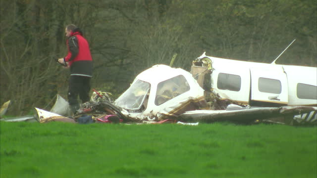 stockvideo's en b-roll-footage met exterior shots of the wreckage of a light aircraft in which four members of the same family were killed in a field in somerset near the village of... - yeovil