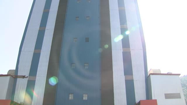 vídeos de stock, filmes e b-roll de exterior shots of the xichang satellite launch center in sichuan province where launch of the new beidou navigation satellite system satellites into... - missão espacial