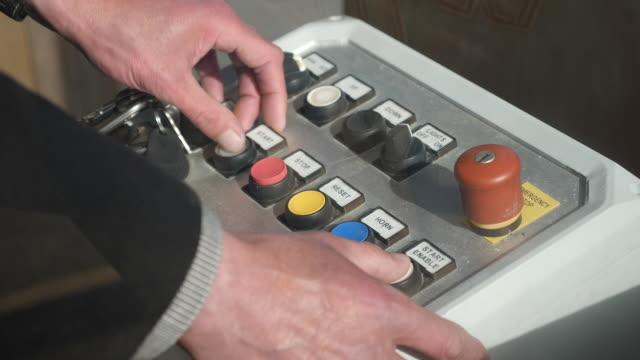 stockvideo's en b-roll-footage met exterior shots of theme park ride control panel on 20 april 2020 in tredinnick, england, - drukknop