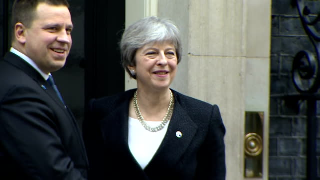 Exterior shots of Theresa May and Estonian Prime Minister Jüri Ratas shaking hands and posing briefly on the steps of Number 10 Downing Street and...