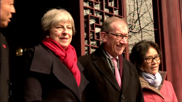 Exterior shots of Theresa May and her husband Philip touring the Yu Yuan Temple Gardens and posing for a photo opportunity with local officials>> on...