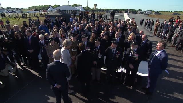 exterior shots of theresa may and president emmanuel macron of france meeting veterans taking part in a special service at the new british dday... - d day stock-videos und b-roll-filmmaterial