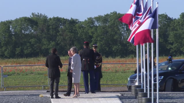 exterior shots of theresa may arriving at the new dday memorial overlooking gold beach talking to various people on 6 june 2019 in versurmer france - d day stock-videos und b-roll-filmmaterial