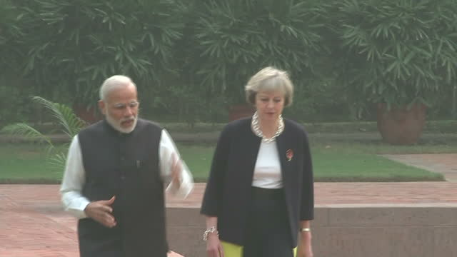 Exterior shots of Theresa May being greeted by Indian Prime Minister Narendra Modi and walking around the gardens of Hyderabad House together before...