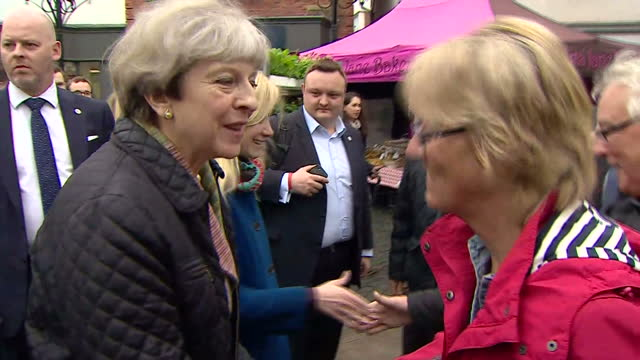 exterior shots of theresa may campaigning in abgingdon meeting members of the public with nicola blackwood conservative candidate for abingdon being... - conservative party uk stock videos and b-roll footage