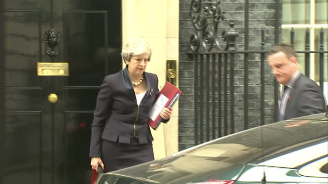 exterior shots of theresa may departing from number 10 downing street to attend prime ministers questions at the house of commons - theresa may stock videos & royalty-free footage