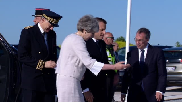 exterior shots of theresa may greeting french president at the new dday memorial overlooking gold beach on 6 june 2019 in versurmer france - d day stock-videos und b-roll-filmmaterial