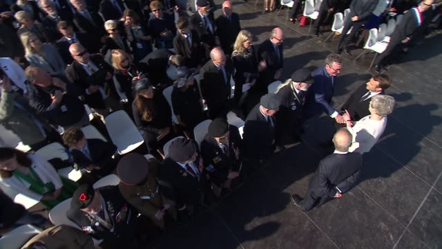 exterior shots of theresa may meeting veterans taking part in a special service at the new british dday memorial marking the 75th anniversary of the... - d day stock-videos und b-roll-filmmaterial
