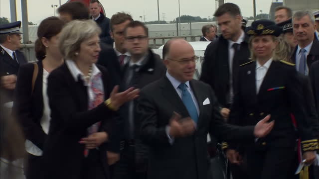 exterior shots of theresa may mp, home secretary of united kingdom and bernard cazeneuve interior minister of france arriving in calais and greeting... - bernard cazeneuve stock videos & royalty-free footage