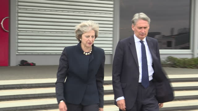 exterior shots of theresa may mp, prime minister and philip hammond mp, chancellor, boarding a plane bound for the g20 summit on september 03, 2016... - smart casual stock videos & royalty-free footage