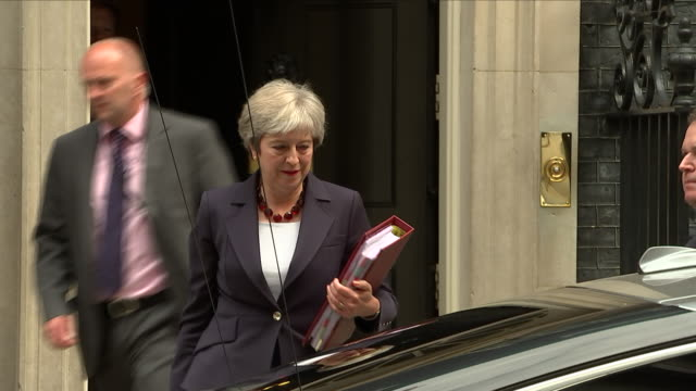 exterior shots of theresa may, prime minister of britain departing from 10 downing street to attend the prime minister's questions on 5th september... - prime minister's questions stock videos & royalty-free footage