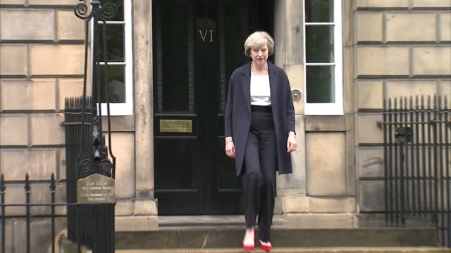 exterior shots of theresa may prime minister walking out of bute house whilst on a visit to ruth davidson leader of the scottish conservative and... - theresa may stock videos & royalty-free footage
