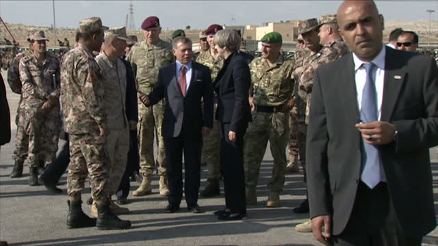 Exterior shots of Theresa May visiting a military base with King Abdullah II of Jordan meeting soldiers and looking at military equipment before...