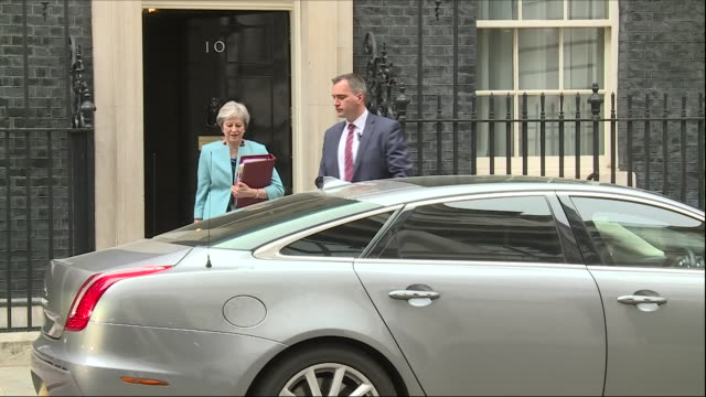 exterior shots of theresa may walking from downing street to ministerial car en route to prime ministers' question time on 16 may 2018 in london... - theresa may stock-videos und b-roll-filmmaterial