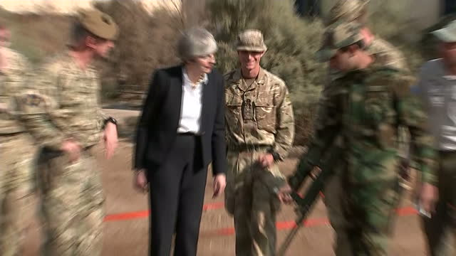 Exterior shots of Theresa May watching a demonstration of British military personnel training Iraqi troops on how to use metal detectors to sweep for...