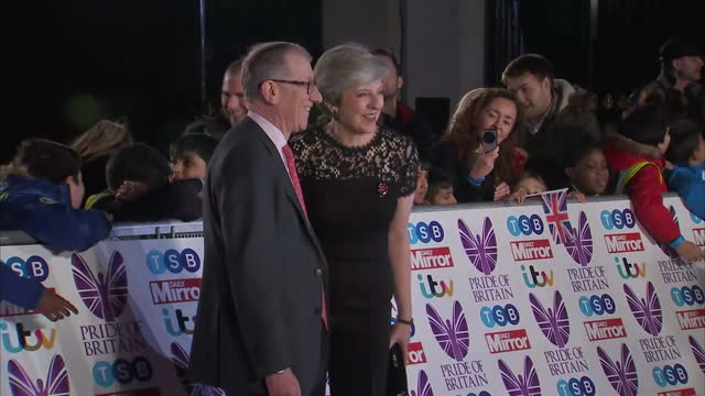 Exterior shots of Theresa May with her husband Philip May arriving on the red carpet for the Pride of Britain Awards and greeting members of the...