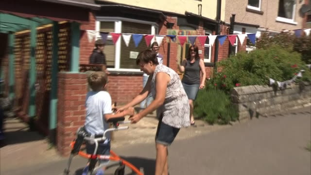 exterior shots of tobias weller, 9-year-old boy with cerebral palsy completing his marathon walk in aid of charity cheered on by neighbours, on 31... - cerebrum video stock e b–roll