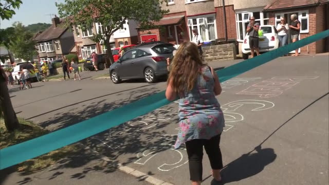 exterior shots of tobias weller, 9-year-old boy with cerebral palsy completing his marathon walk in aid of charity cheered on by neighbours as he... - cerebrum video stock e b–roll