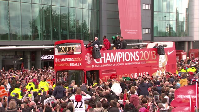 exterior shots of tom cleverley and shinji kagawa on top of champions parade bus holding premier league trophy and fans surrounding manchester united... - east asian ethnicity stock videos & royalty-free footage