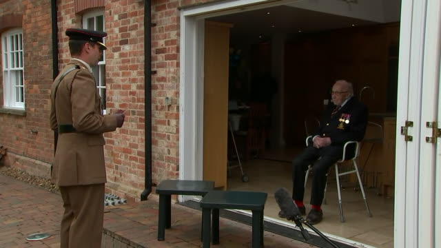 exterior shots of tom moore receiving the yorkshire regiment medal along with his new rank of colonel to mark his 100th birthday on 30 april 2020 in... - captain tom moore stock videos & royalty-free footage