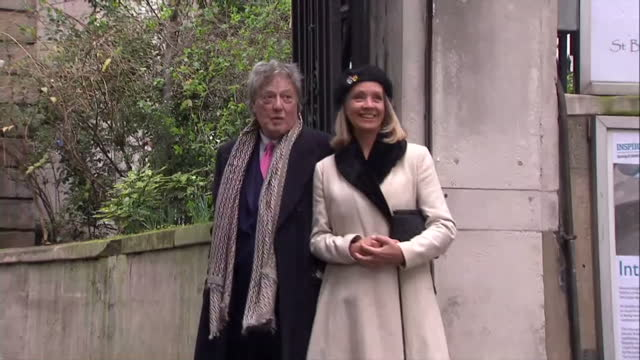 exterior shots of tom stoppard wife sabrina guinness pose for photo op before entering st brides church for the wedding of rupert murdoch and jerry... - rupert murdoch stock videos and b-roll footage