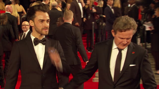 exterior shots of tommy tonge and john logan attending the royal world premiere of 'spectre' at royal albert hall on october 26 2015 in london england - spectre 2015 film stock videos and b-roll footage