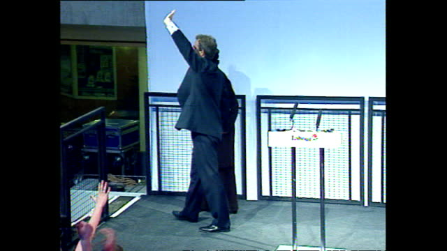exterior shots of tony blair and cherie on stage and greeting cheering crowds with john and pauline prescott after labour's 1997 election victory on... - 労働党点の映像素材/bロール