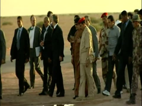 exterior shots of tony blair british prime minister and colonel gaddafi libyan leader wlk from tent surrounded by entourage exterior shots of blair... - muammar gaddafi stock videos & royalty-free footage