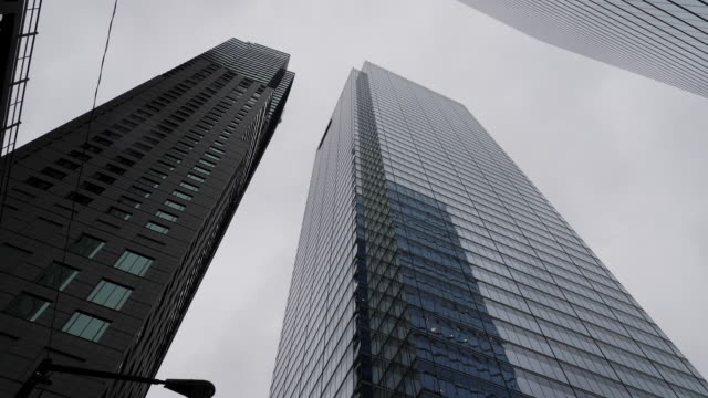 exterior shots of toronto city centre including high rise skyscrapers traffic on city centre streets and various businesses on 13 january 2020 in... - skyscraper stock videos & royalty-free footage