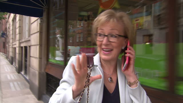 exterior shots of tory leadership contender andrea leadsom mp walking along millbank and answering reporter's question 'just waiting to see what... - andrea leadsom stock-videos und b-roll-filmmaterial