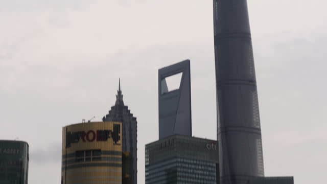 exterior shots of tourists having photos taken with the shanghai skyline in the background, including shanghai world financial center, aurora plaza,... - lujiazui stock videos & royalty-free footage