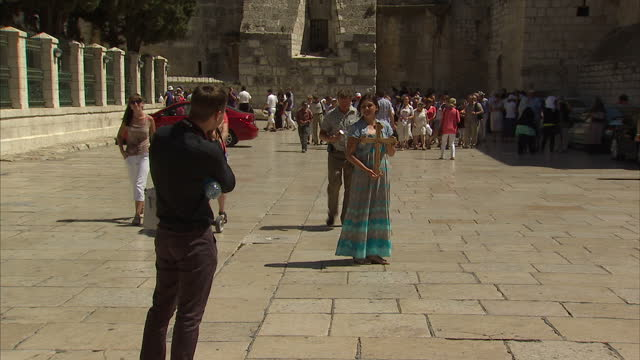 exterior shots of tourists milling around outside the church of the nativity in bethlehem israel general views of bethlehem israel on september 04... - church of the nativity stock videos and b-roll footage