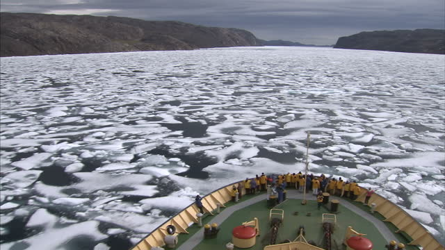 exterior shots of tourists on an expedition through the north west passage looking out at ice floes on the bow of an icebreaker on august 25 2007 in... - northwest passage stock videos and b-roll footage