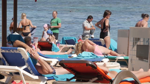 exterior shots of tourists sunbathing and relaxing on the beach at the rixos hotel resort on november 05, 2015 in sharm ash shaykh, egypt. - tourism stock videos & royalty-free footage