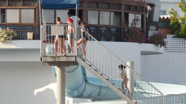 exterior shots of tourists swimming and lounging around pools at a resort in sharm el sheikh on november 08 2015 in sharm el sheikh egypt - adagiarsi video stock e b–roll